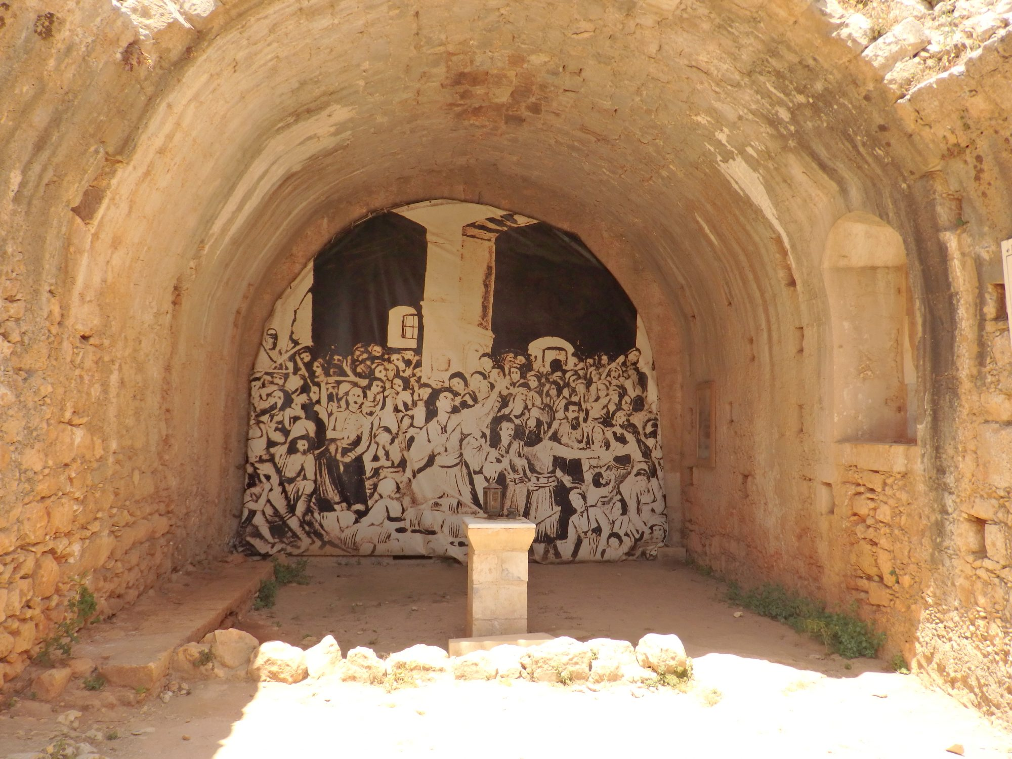The intact end of the powder room at Arkadi is painted as a reminder of the tragedy that happened there.