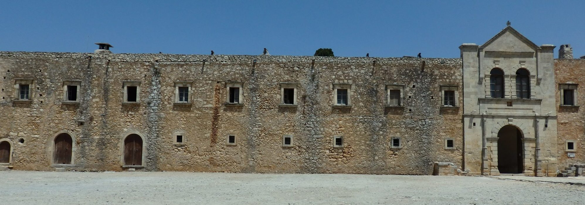 a section of the outer building enclosing the courtyard of Arkadi monastery