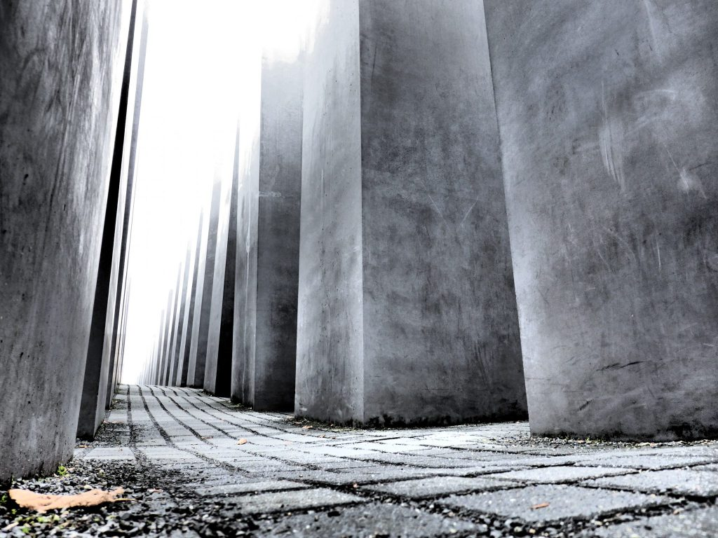 Taken from ground level, the photo sights down a row between the large cement blocks that make up the Memorial.