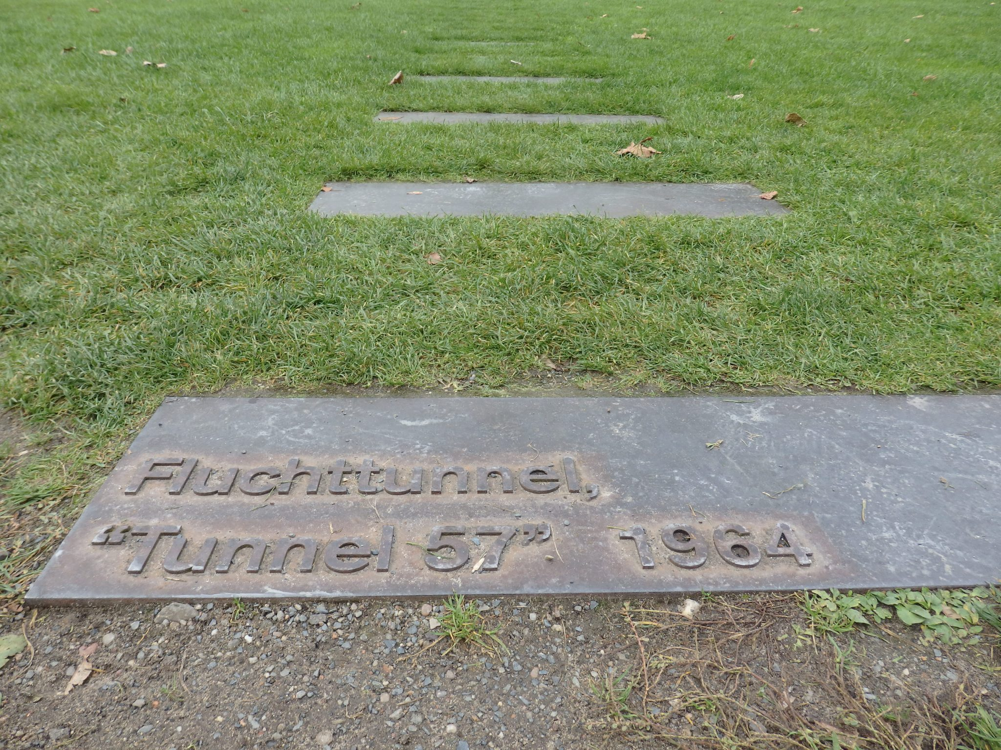 These metal plates mark the route of one of many tunnels dug under the Berlin Wall.