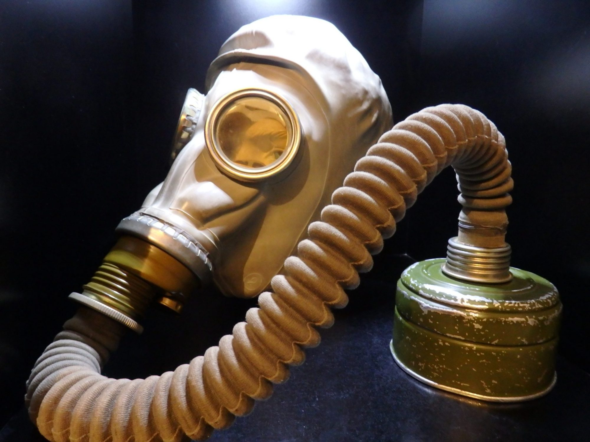 a gas mask in a cupboard in the DDR Museum