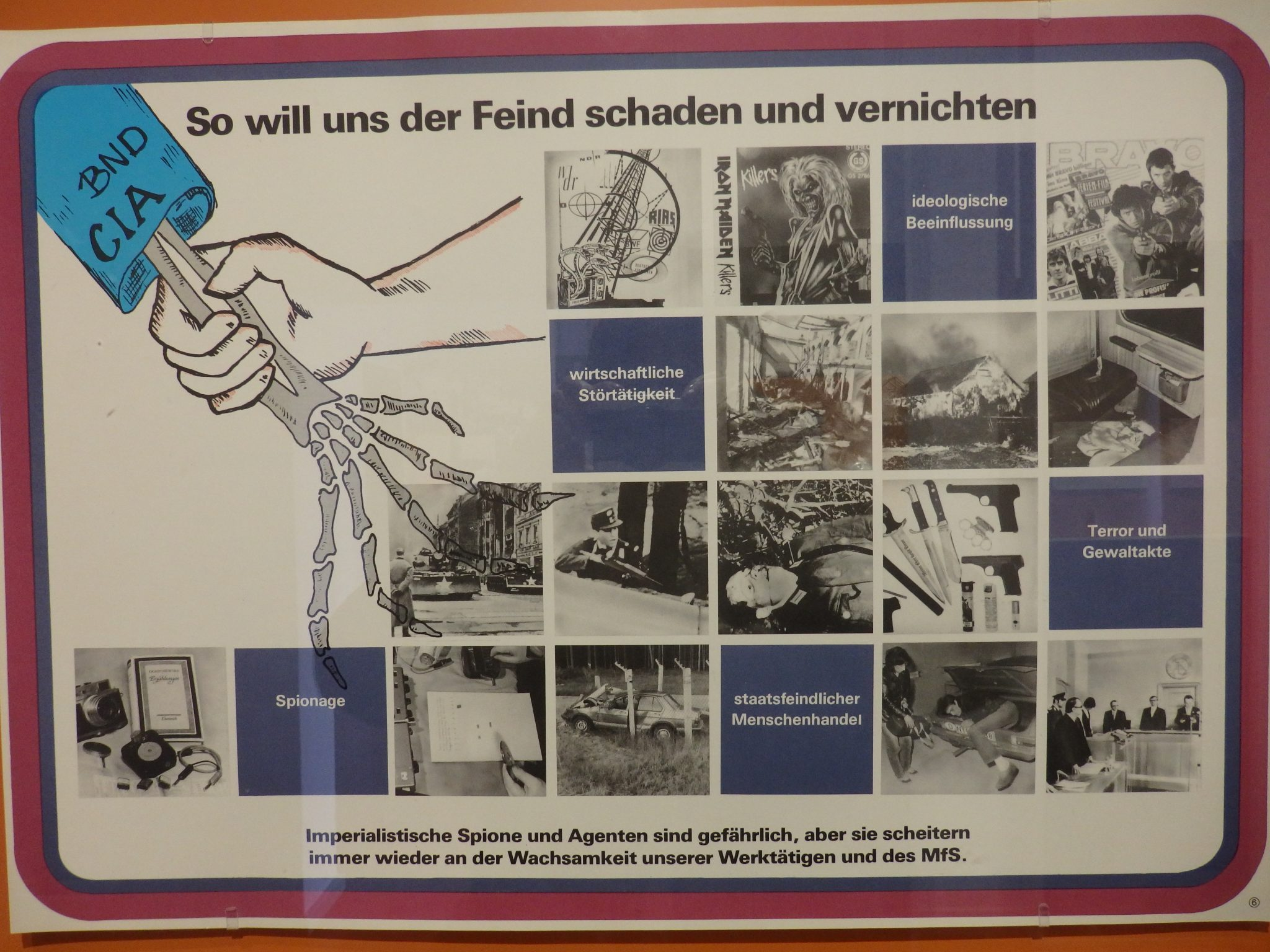 """This training poster from the Stasi Museum says """"This is how the enemy wants to harm and destroy us."""""""