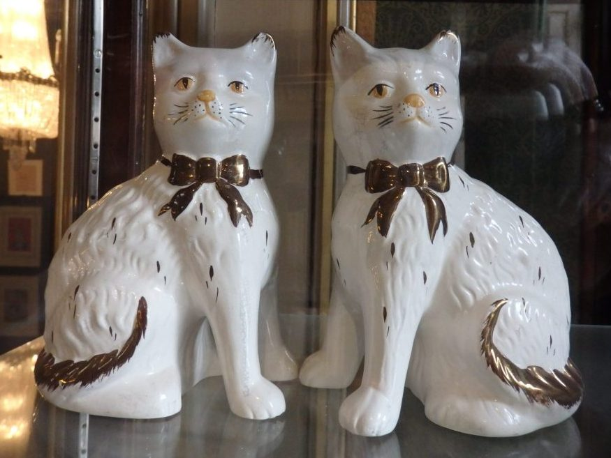 Ceramic cats in a cabinet at the Cat Cabinet, Amsterdam