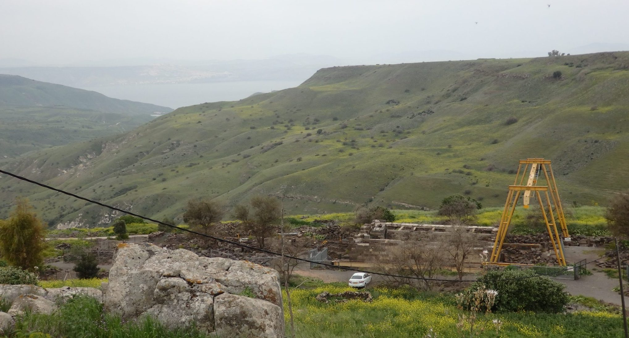 his is the view over the hills of the Golan Heights that opened up once I had descended a short distance down the path from the parking lot. You can see the Sea of Galilee in the haze in the distance. In the foreground is the ruin of the Um el Kanatir synagogue.