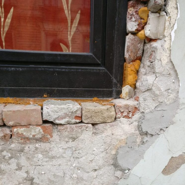 exposed brick under a window in Timisoara, Romania. Timisoara photo essay.
