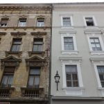 The contrast between these two buildings is remarkable. The one on the left is down to the underlying brickwork in places while the one on the right is pristine. What is not clear is how much the restoration on the right involved removing decorative elements. I suspect some plasterwork was removed, since the originals of this type generally have different window frames for each row, as you can see on the building on the left. Visiting Timisoara: faded glory