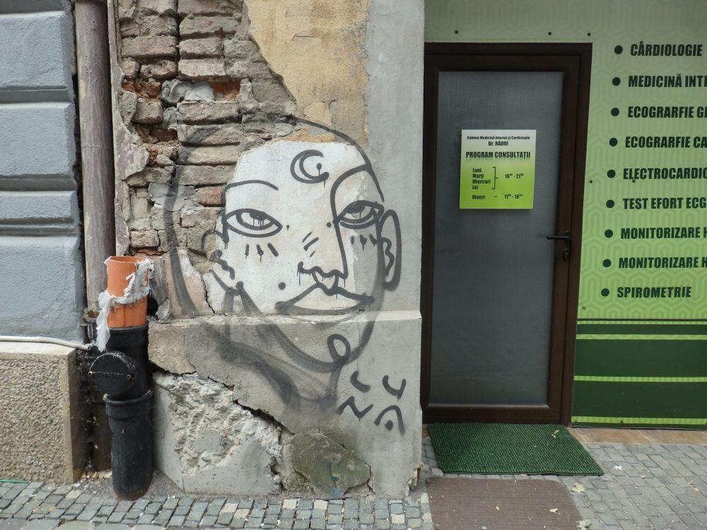 graffiti of the face of a woman in Timisoara, Romania. Timisoara photo essay.