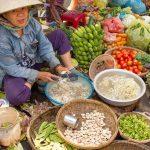 a market vendor in Hoi An, Vietnam. Photo courtesy of Anita Breland of Anita's Feast.