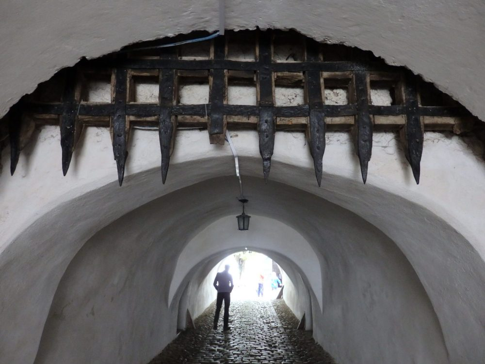a portcullis in the entrance to Prejmer fortified church