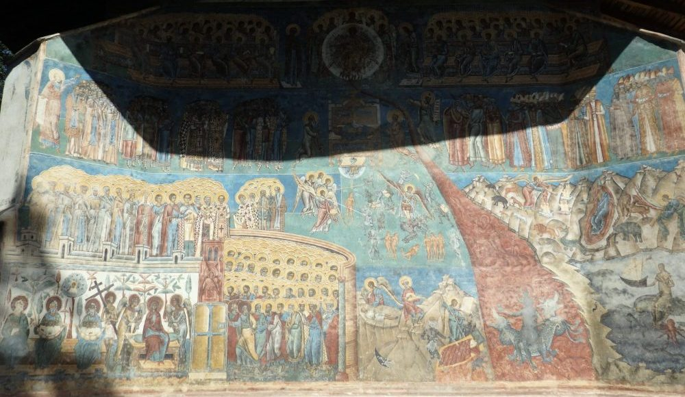 Not the best photo, but here's the bottom half of the wall, showing the river of fire, naked tortured souls, and a multitude of saints. The Spectacular Painted Churches of Moldavia.