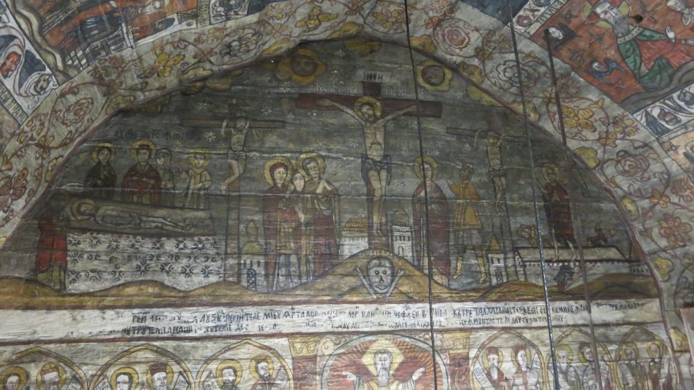 Above the altar inside of Desesti's church is a depiction of the crucifixion. Wooden churches of Maramures.