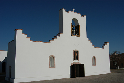 The simple, stepped façade of Socorro Mission. Image via Flickr by misha3637