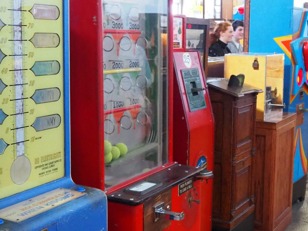 a row of various arcade machines, including the peepshow type, at the Musee Mecanique penny arcade.