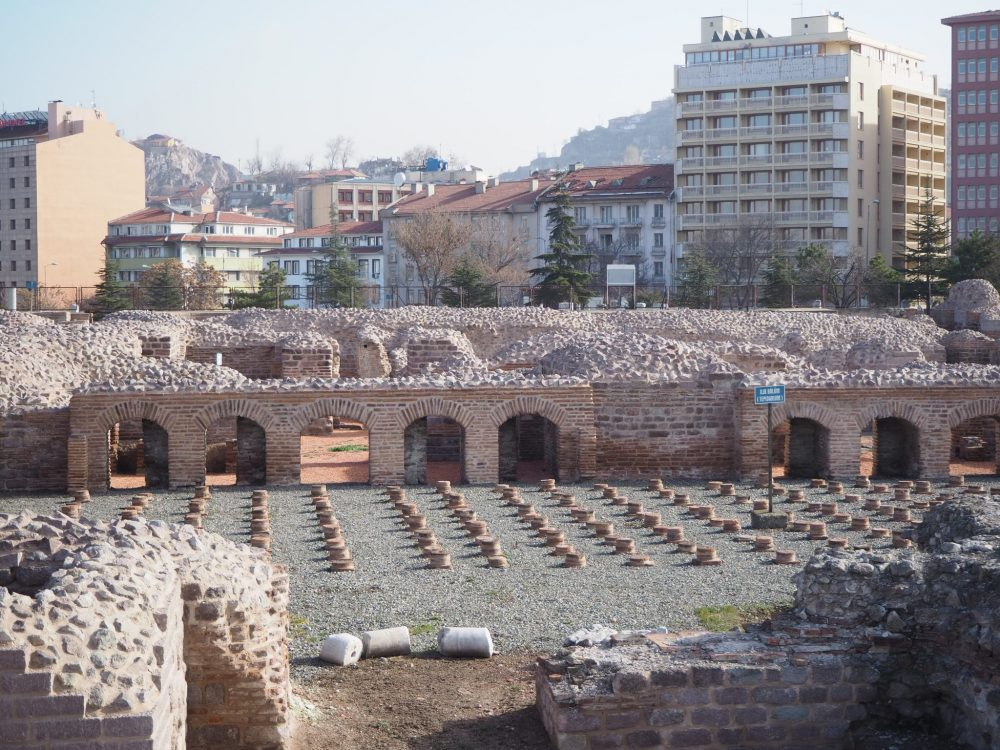 A view of a section of the Roman Baths in Ankara, Turkey, shows the small columns that once held up the floor. Sightseeing in Ankara