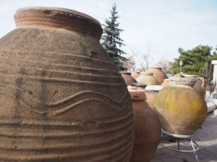 a cluster of large clay pots outside of the Museum of Anatolian Civilization