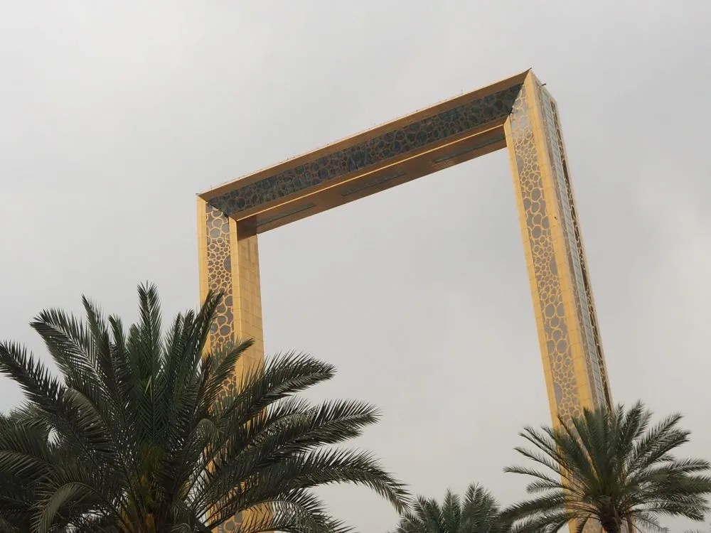 The Dubai Frame. I thought it was just behind those palm trees and perhaps twice as tall as them...