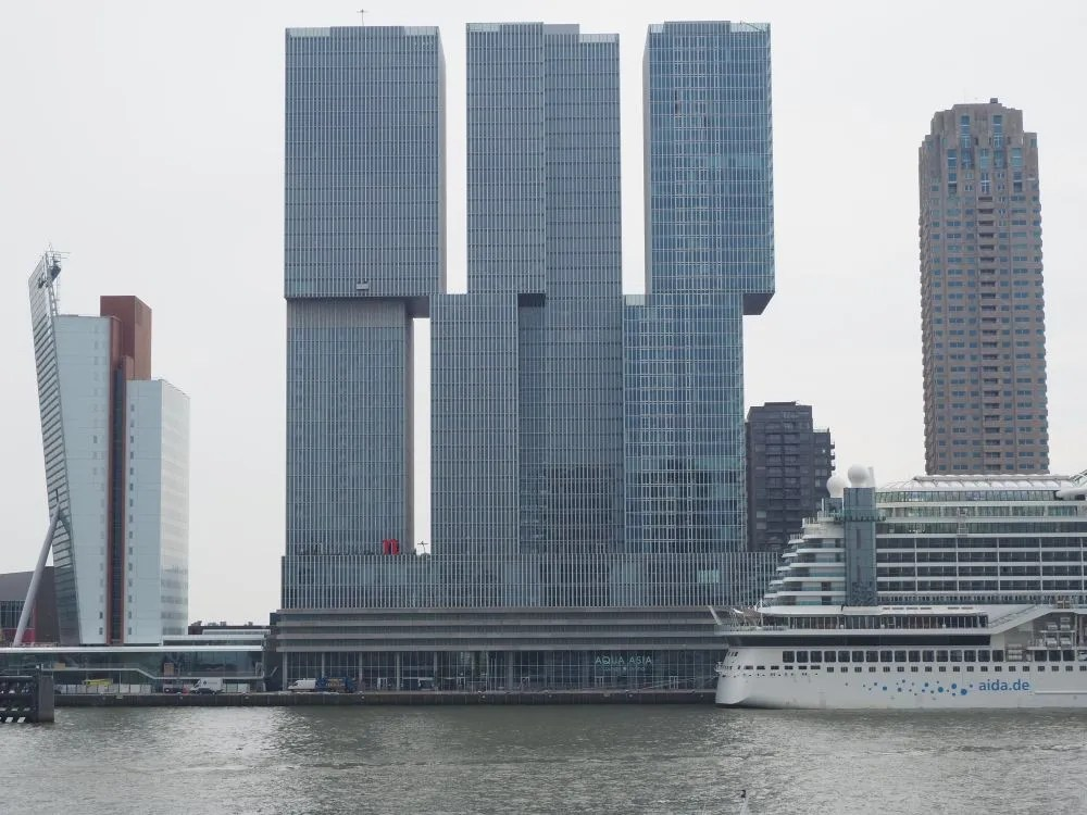 The De Rotterdam, as seen from across the Maas River. Notice the window cleaners on the left-hand tower.