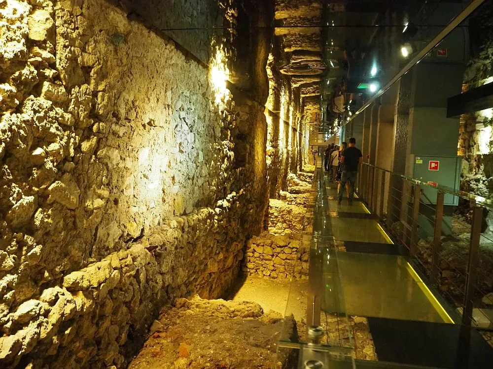 A long hallway reveals market cellars, walls and foundations in the Rynek Underground Museum.