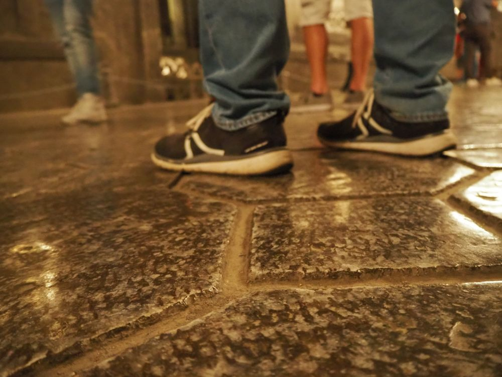 The floor of the Chapel of St. Kinga in Wieliczka Krakow salt mine. (I have no idea who the legs belong to.)