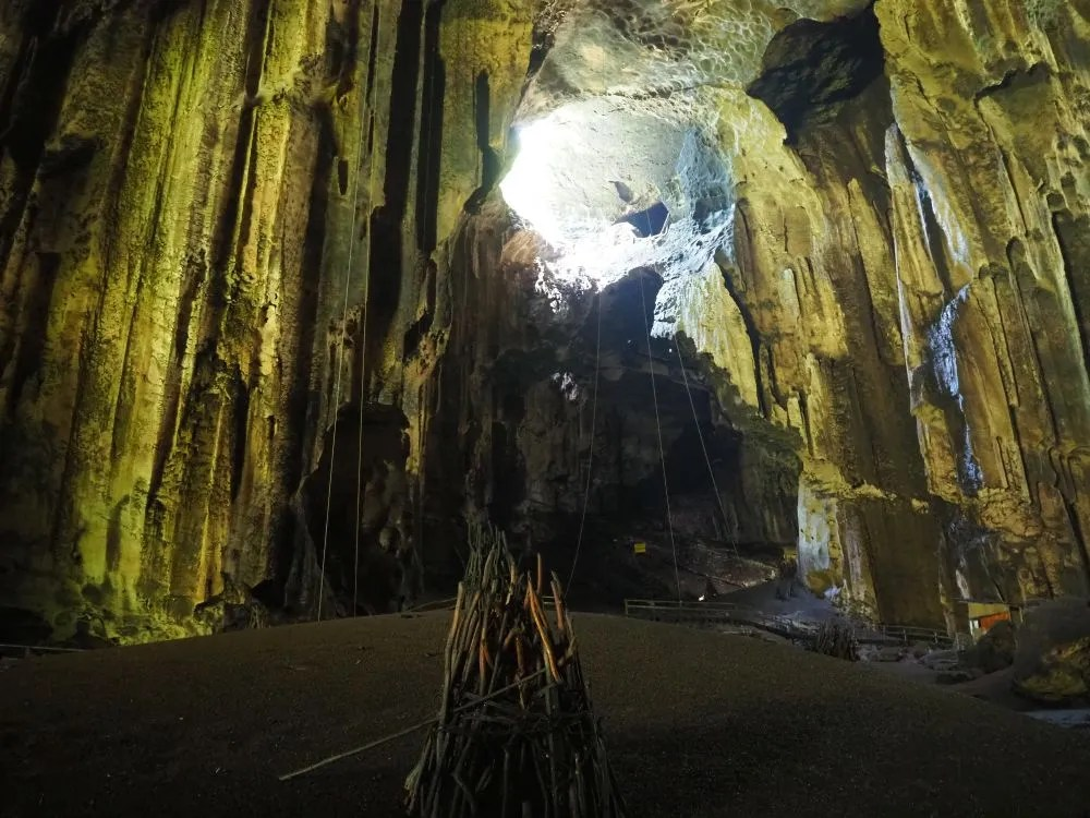 In this view of the cave, you can see the pile of bat sh*t in the foreground. The ropes that dangle down the walls are used for reaching the nests, which are up high near the top of the cave.