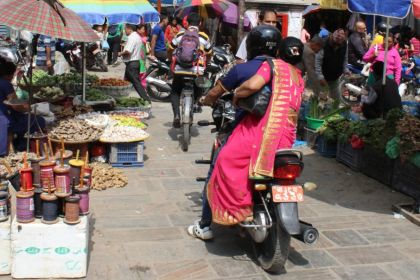 A motorcycle navigating a busy street in Kathmandu, Nepal.