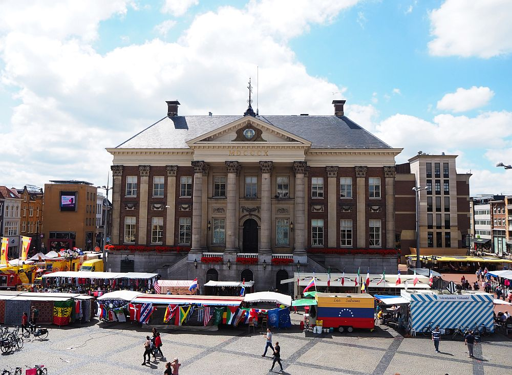 Groningen city hall, in the center of the town where I live. I took this photo on a market day, which is why it's surrounded by all those stalls.
