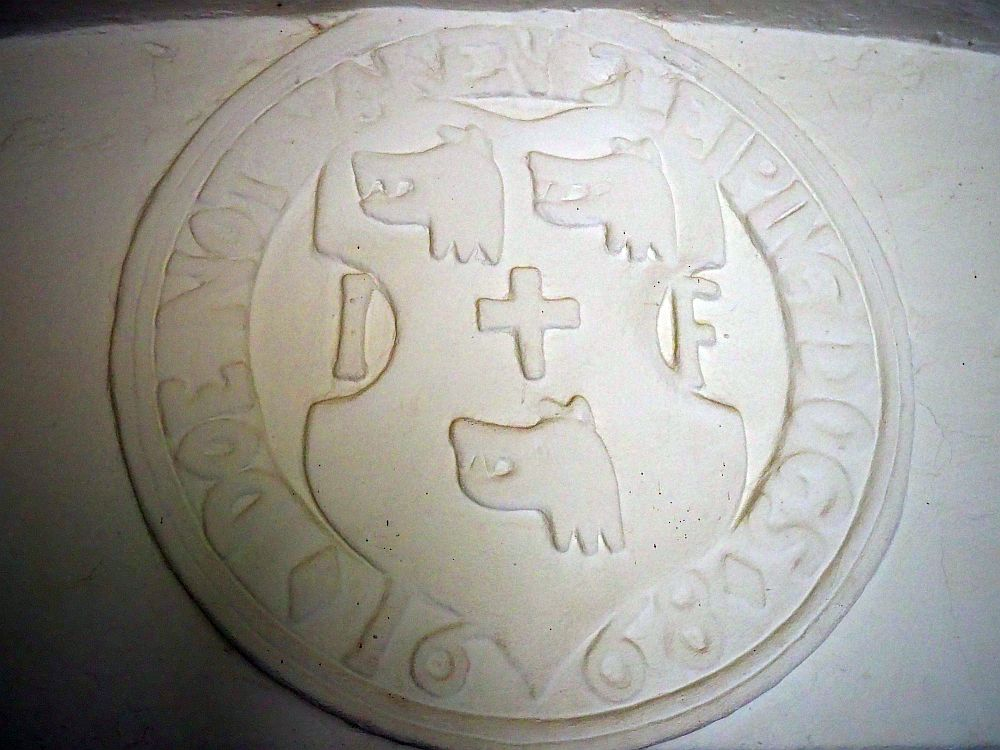 """This coat of arms, from just inside the entrance to Craigievar Castle, says """"Doe not waken slieping dogs."""""""