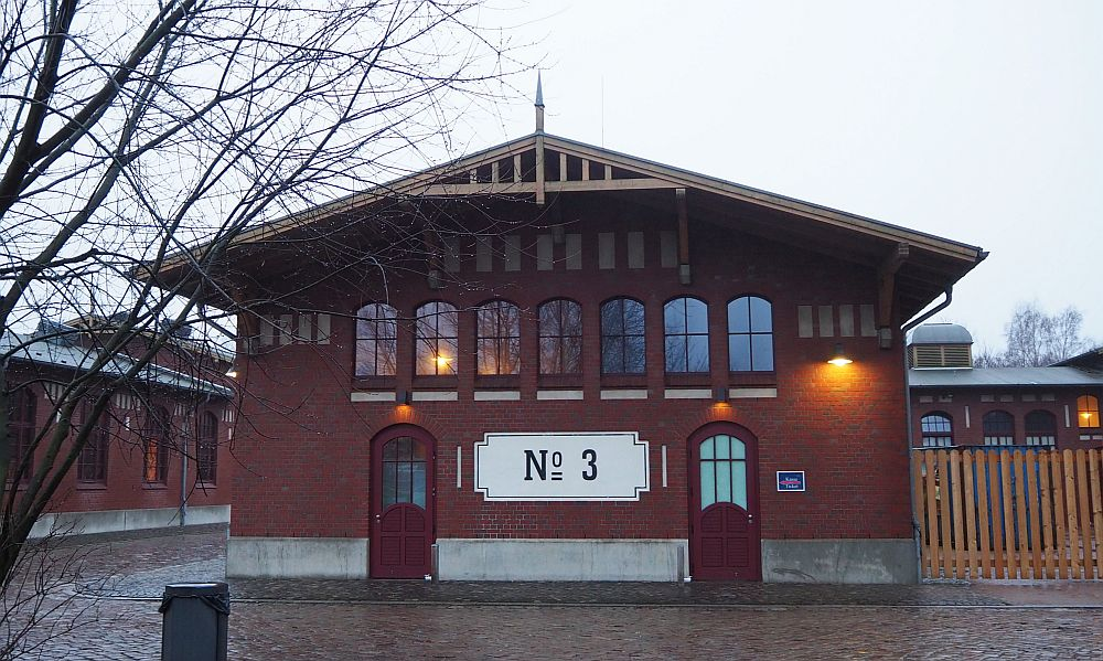 The building is only two stories, with a peaked roof and arched windows.