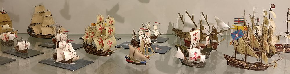 Tiny scale models of historical ships, complete with detailed sails and rigging.