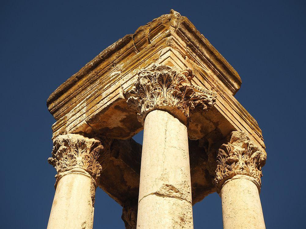 Four Corinthian columns support a square pediment at Anjar.