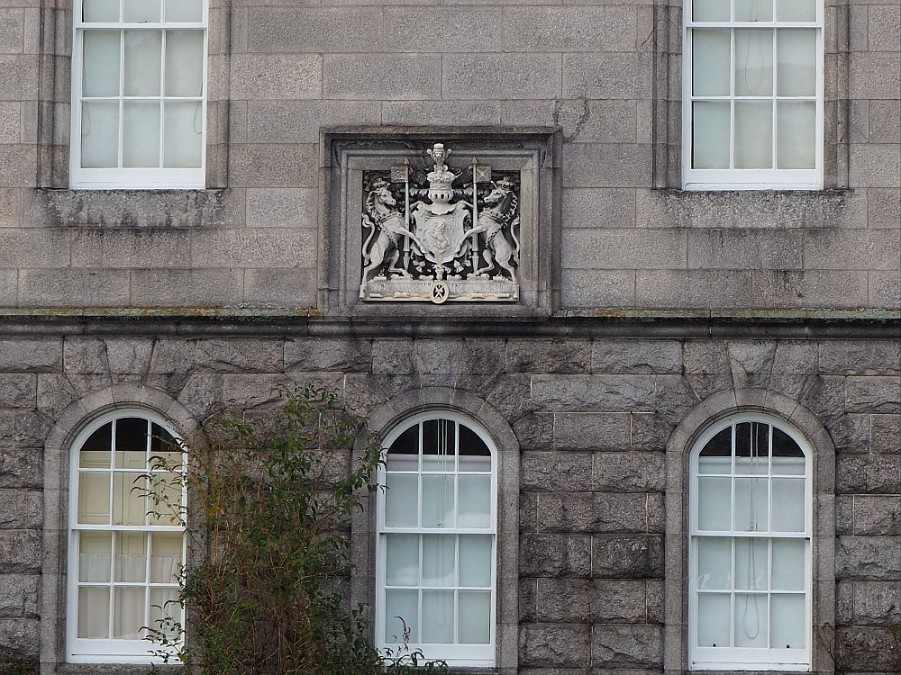 The coat of arms has a crest with a lion in the middle, flanked by a rearing unicorn on either side.