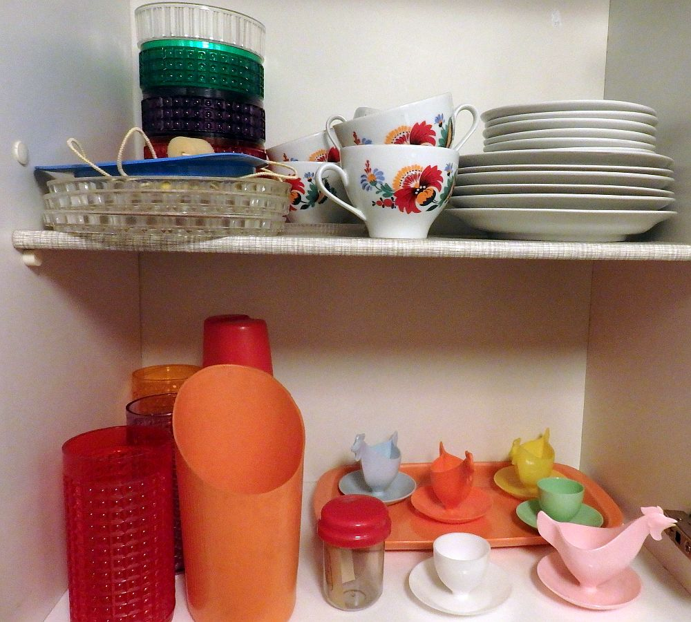 The cups are plastic, the china painted with bright flowers. Typical cheap kitchenware sold in the DDR.