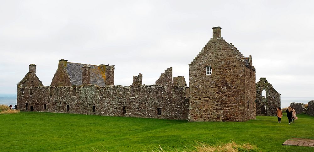 a wide, low stone building, mostly roofless, at Dunnottar Castle.