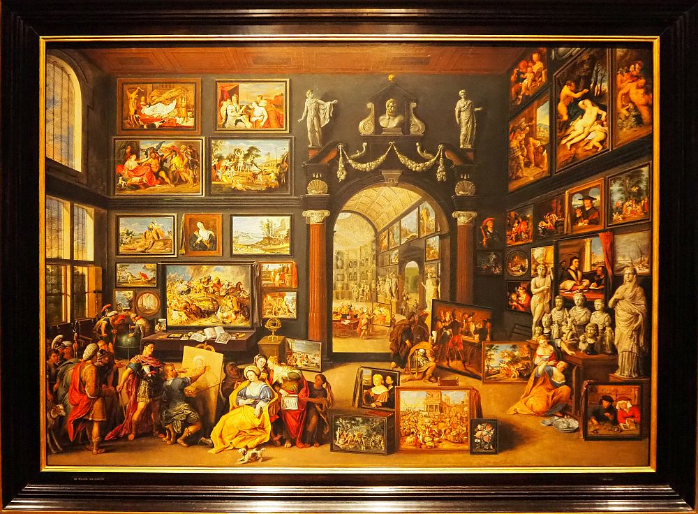 The painting shows an artist painting a portrait in an enormous room, where the walls are covered with finished paintings. These paintings within the painting are remarkably detailed.
