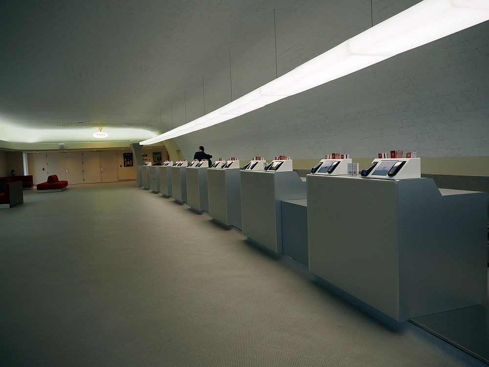 A long row of counters: white, with a white floor and a white wall behind and at the end in the distance.