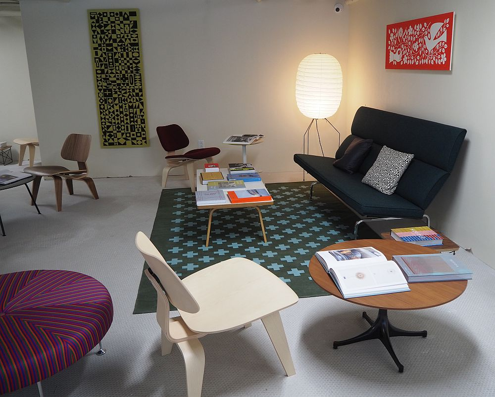 The furniture in the reading room has a sofa, a coffee table and several chairs, all in designs that were chic in 1962.