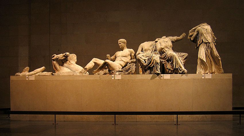 From left to right, the figures show a horse (dying, perhaps, because it is low to the ground), a naked man reclining, missing a hand but otherwise intact; and three figures that are draped in cloth (togas?) but all of these are missing their heads and limbs. Originally the set would have fit into a pediment, so the figures are lower on the left and taller on the right.