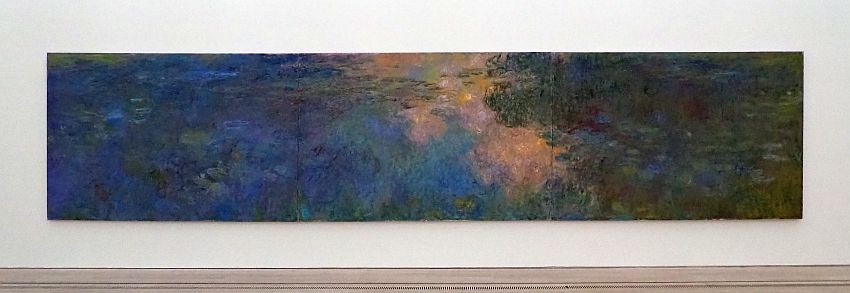 An impressionistic horizontal view, very long and thin. It seems to show a body of water with green plants (water lilies?) growing on it and clouds reflected in the parts that are not covered with plants.