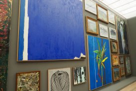 A view of a wall full of artworks