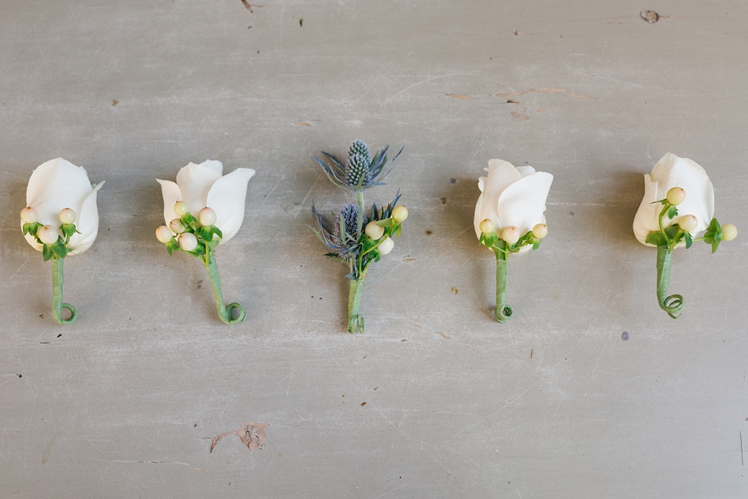 boutonnieres against concrete floor for a clean modern look