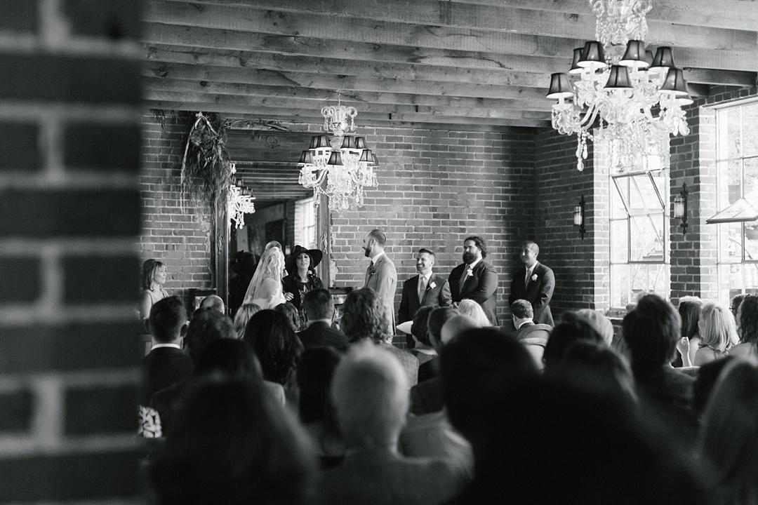 black and white photo of wedding ceremony at carondelet house