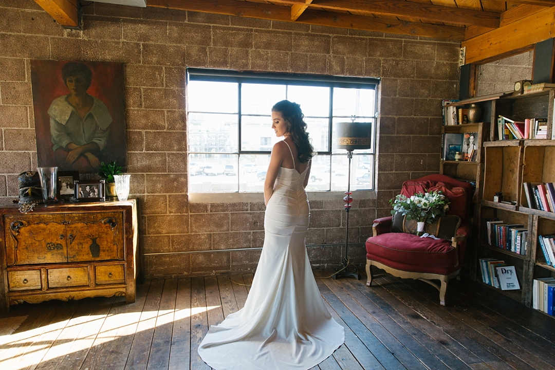 dramatic photo of bride by window at smoky hollow studios