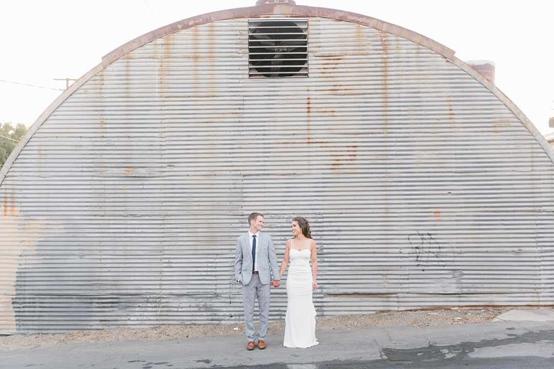 bride and groom holding hands outside their venue in el segundo