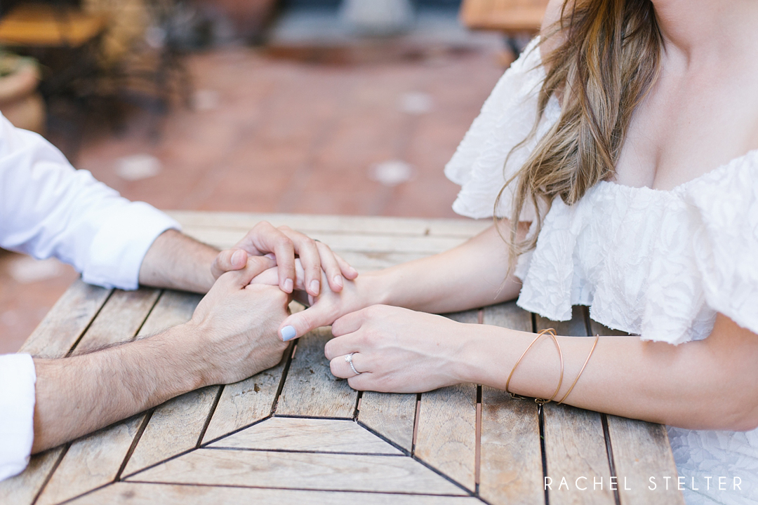 couple holds hands at engagement session in laguna beach