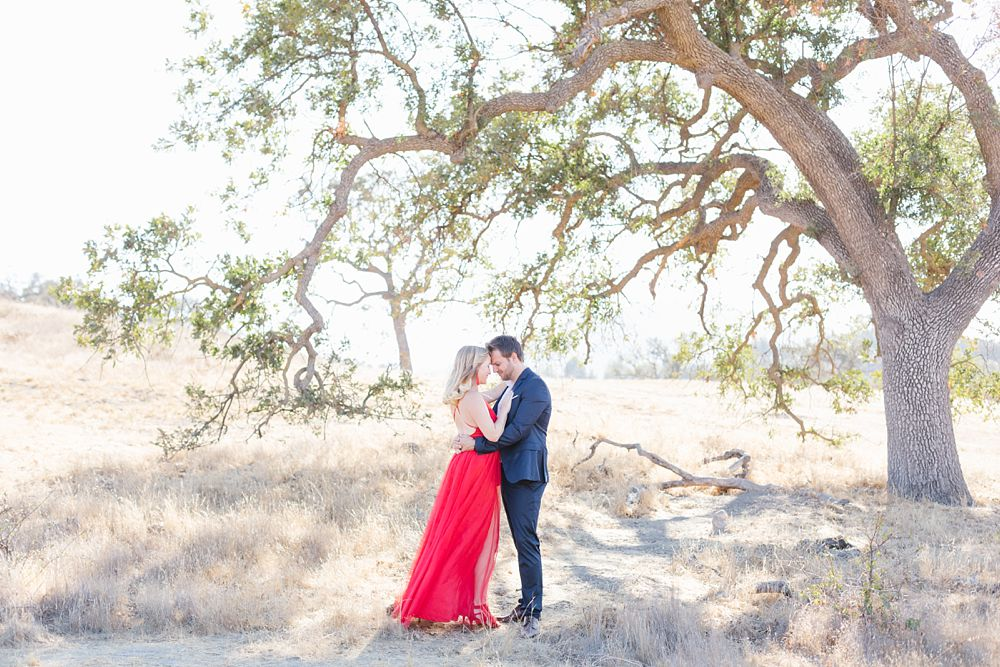 stylish Southern California anniversary session with red dress