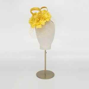 Yellow silk pillbox with veil
