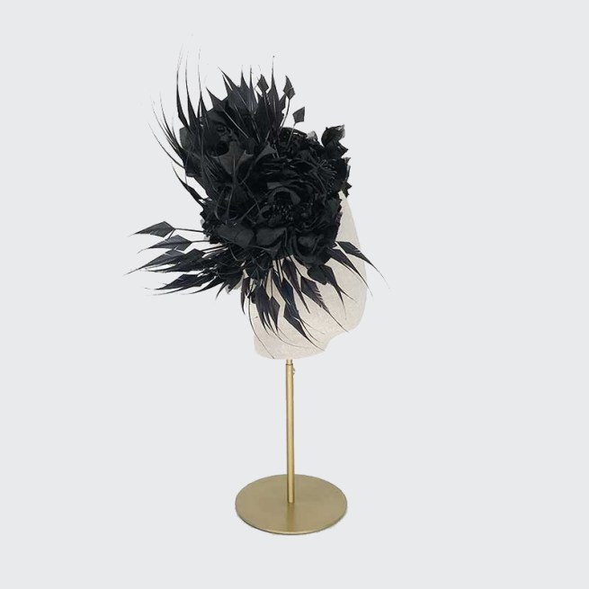 Black roses on crescent with feathers