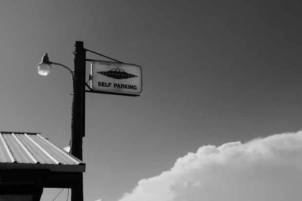 grayscale photo of stop sign