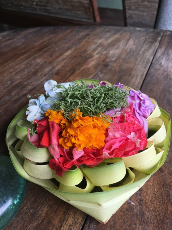 Palm basket with a daily offering of flowers and rice for the spirits