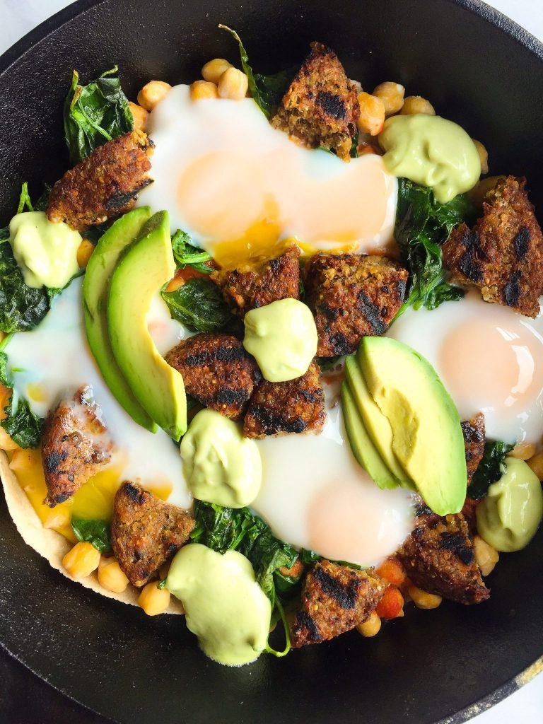 Healthy Veggie Huevos Rancheros Skillet Bake with Avocado Crema